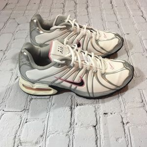 White and silver Nike air size 8